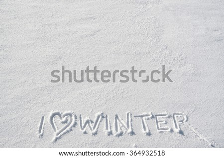 Text I LOVE WINTER and heart symbol hand written on snow background. Horizontal postcard template. Space for copy, lettering. - stock photo