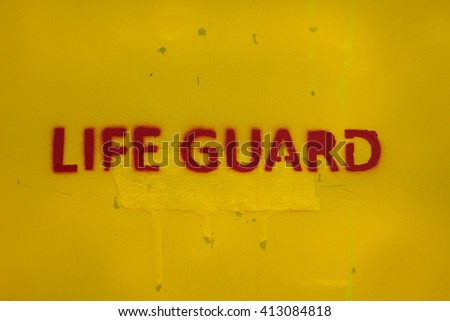 Text Life Guard sprayed a the wall of a life guard stand on a beach or pool - stock photo