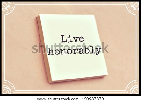 Text live honorably on the short note texture background - stock photo