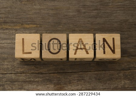 text LOAN on a wooden cubes - stock photo