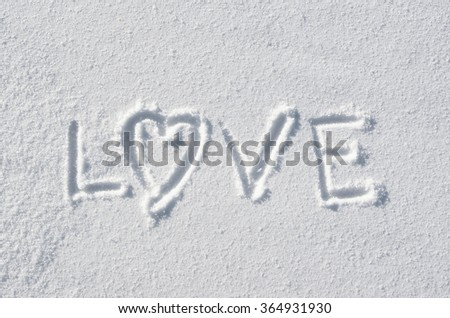 Text LOVE and heart hand written on snow background. Horizontal valentines postcard template. - stock photo