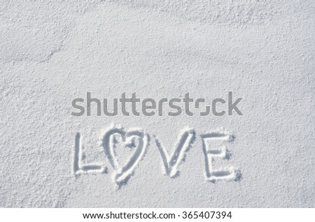 Text LOVE and heart hand written on snow background. Horizontal valentines postcard template. Space for copy, lettering. - stock photo