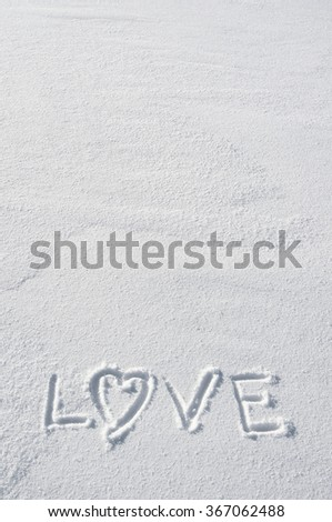 Text LOVE and heart hand written on snow background. Vertical valentines postcard template. Space for copy, lettering. - stock photo