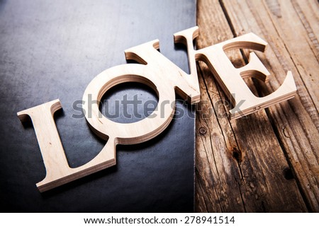 text love on black background - stock photo