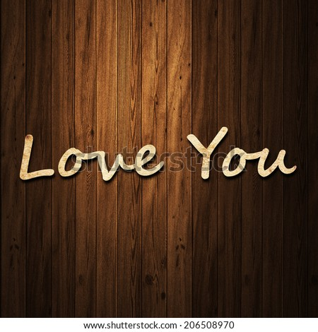 Text Love you  paper on wood background - stock photo