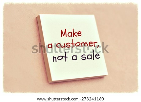 Text make a customer not a sale on the short note texture background - stock photo