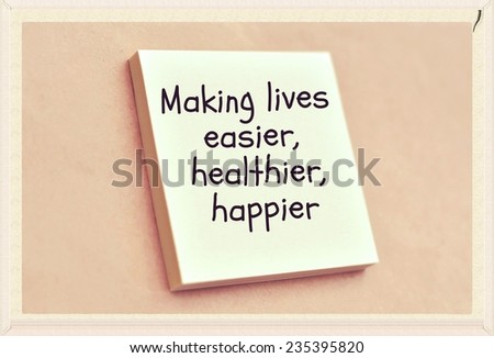 Text making lives easier healthier happier on the short note texture background - stock photo