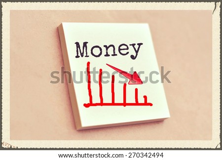 Text money on the graph goes down on the short note texture background - stock photo