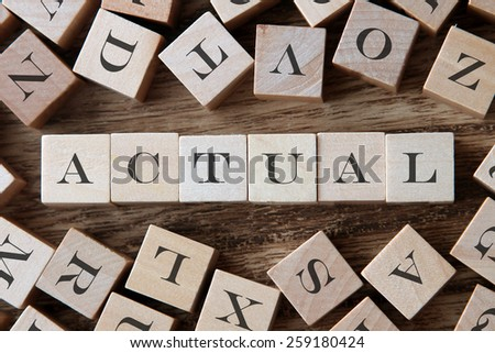 text of ACTUAL on cubes - stock photo