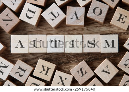 text of AUTISM on cubes - stock photo
