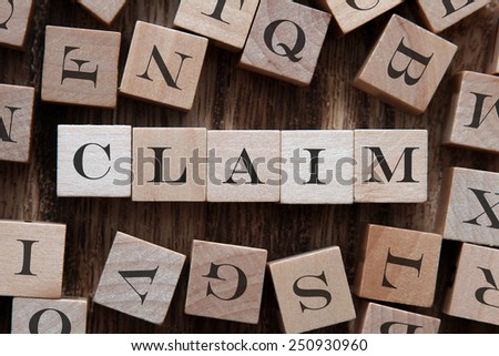 text of CLAIM on cubes - stock photo