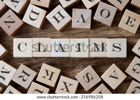 text of CLAIMS on cubes - stock photo