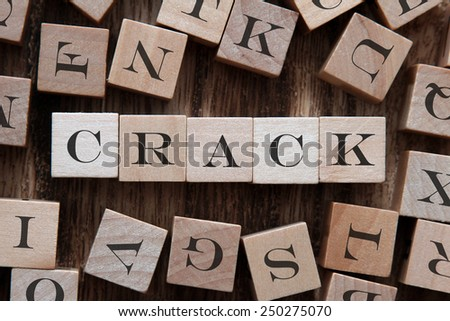 text of CRACK on cubes - stock photo