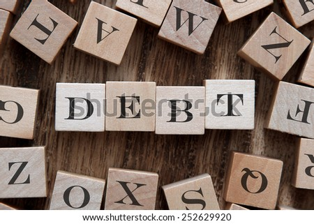 text of DEBT on cubes - stock photo
