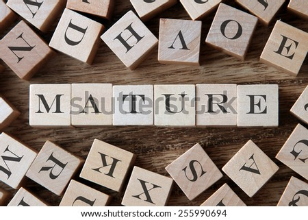 text of MATURE on cubes - stock photo