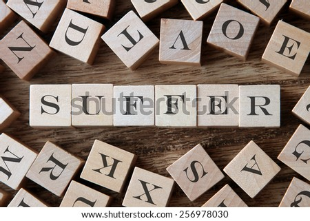 text of SUFFER on cubes - stock photo