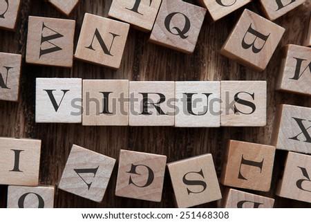 text of VIRUS on cubes - stock photo