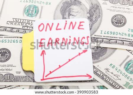Text - On line Earnings. With Graphs and diagrams. Business concept.