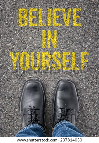 Text on the floor - Believe in yourself - stock photo