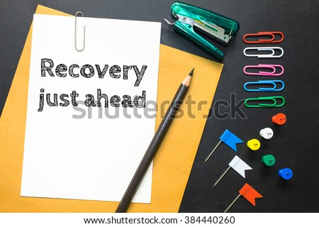 Text recovery just ahead on white paper background / business concept - stock photo