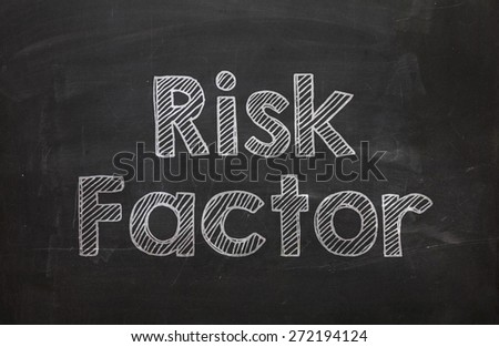 Text Risk Factor handwritten with white chalk on a blackboard - stock photo