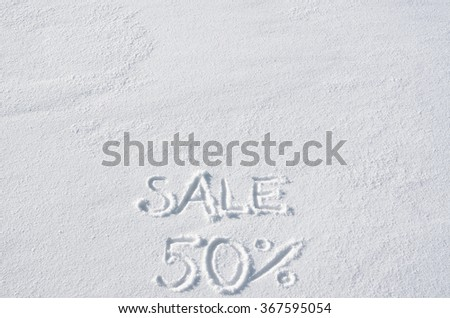Text SALE 50 % hand written on snow background. Horizontal banner template. Space for copy, lettering. - stock photo