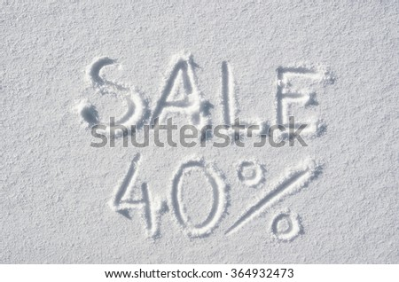 Text SALE 40% hand written on snow background. Horizontal postcard template.