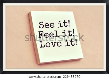 Text see it feel it love it on the short note texture background - stock photo