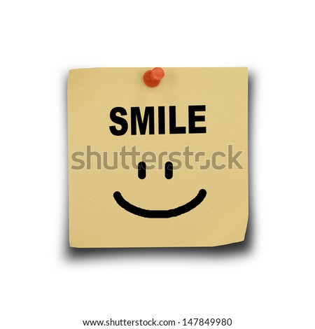 text smile on note paper and pin on white background