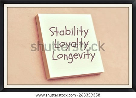 Text stability loyalty longevity on the short note texture background - stock photo