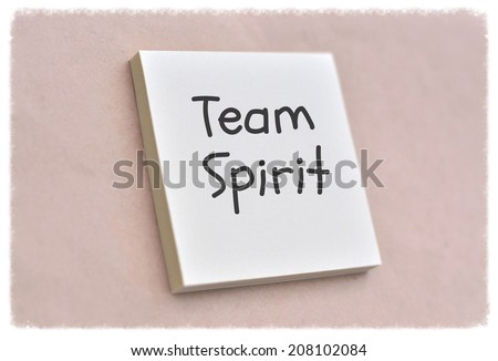 Text team spirit on the short note texture background