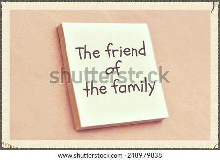 Text the friend of the family on the short note texture background - stock photo