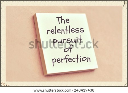 Text the relentless pursuit of perfection on the short note texture background - stock photo