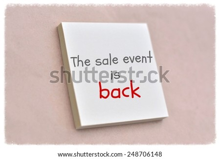 Text the sale event is back on the short note texture background - stock photo