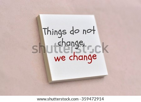 Text things do not change we change on the short note texture background - stock photo