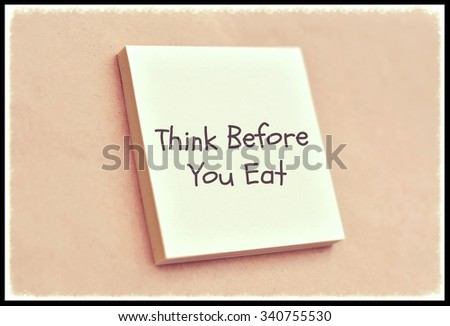 Text think before you eat on the short note texture background - stock photo