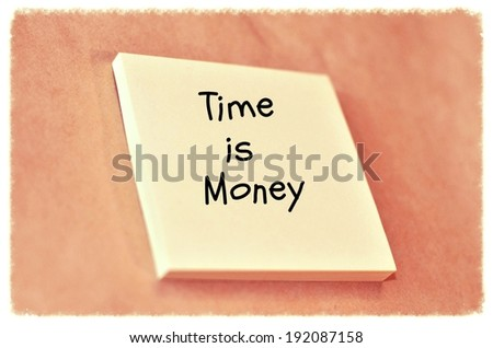 Text time is money on the short note texture background - stock photo