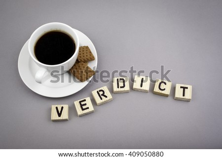 Text: Verdict from wooden letters on a gray background. - stock photo