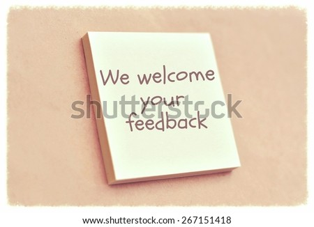 Text we welcome your feedback on the short note texture background - stock photo
