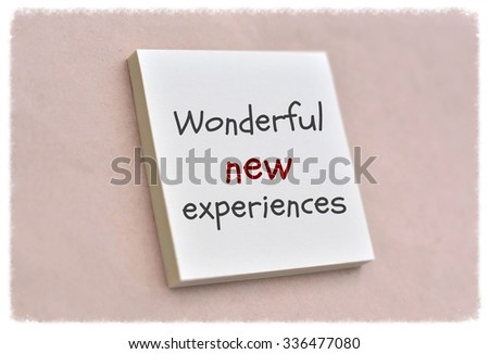 Text wonderful new experiences on the short note texture background - stock photo