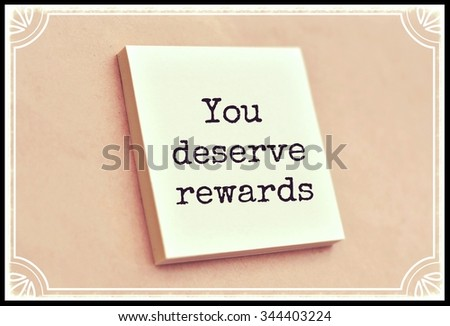 Text you deserve rewards on the short note texture background - stock photo