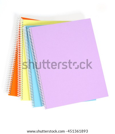 Textbooks of four different colors on white background.