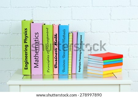 Textbooks on table close-up - stock photo