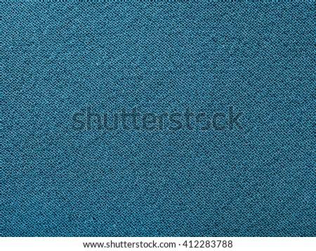 textile background - dark blue green silk fabric with Crepe chiffon (crape chiffon) weave pattern of threads close up - stock photo