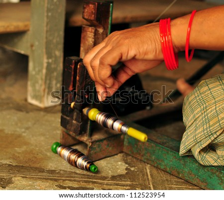 Textile background. Hand weaving on sewing machine. - stock photo