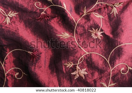 Textile background with embroidered pattern