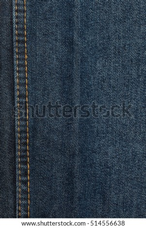 Textile - Fabric Series: Blue Jeans, Close-ups of Details of a pair of jeans trousers with orange stitches