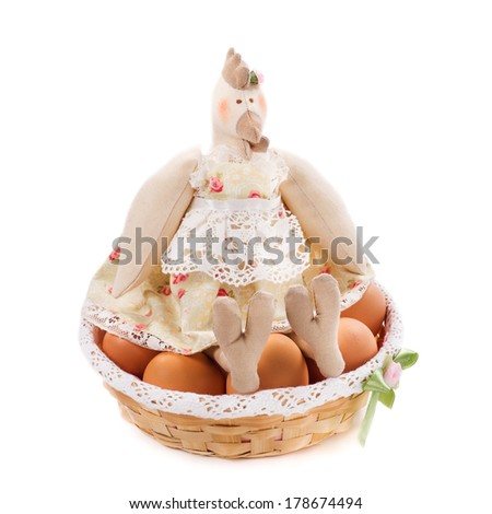 Textile handmade toy (chicken with eggs in the nest)