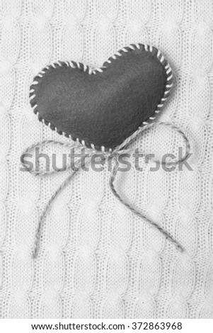 Textile  heart on a white knitted texture