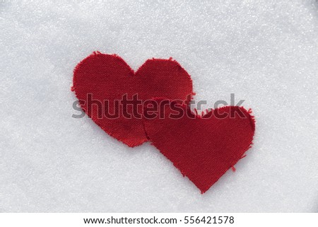 Textile hearts in the snow. Selective focus